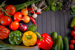 Exposition close up of fresh organic vegetables, composition with assorted raw organic vegetables, red pepper and tomato, cucumber Royalty Free Stock Photo