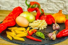 Exposition close up of fresh organic vegetables, composition with assorted raw organic vegetables, red pepper, onion and garlic, g. Reen pepper and red hot chili Stock Photography