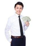 Exposition d'homme d'affaires avec le billet de banque Photographie stock