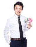 Exposition d'homme d'affaires avec RMB Photographie stock