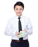 Exposition d'homme d'affaires avec USD Photographie stock libre de droits