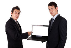 Exposition d'homme d'affaires sur l'ordinateur portatif blanc Photographie stock libre de droits