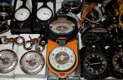 Various models of compasses. The exposition of the exhibition sale of accessories for tourists. Several models of compasses and curvilometers were presented Stock Image