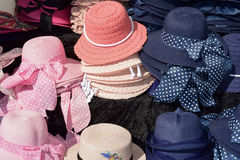 Female straw caps. Exposition of female hats in a regional market Stock Images