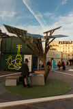 The exposition on  Paris town hall square. Paris; France-December 07; 2015: The people seeing the generous tree-first solar tree -autonomous source of energy Stock Photos