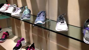 Exposition of sport shoes stock footage