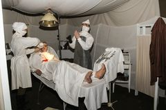 Wax figures wounded and medical staff. Expositions of fragments of the military field hospital at the Lenrezerv exhibition Stock Image