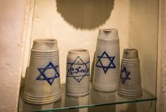 Expositions at the Museum of the Oktoberfest festival mugs, bottles history of celebration. stock photos