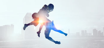 Exposure of American football players . Mixed media Stock Images