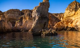 Lagos Caves and Seashore with its Esmerald and Blue Water. Exposure done in a boat tour in the Lagos seashore, Algarve, Portugal Royalty Free Stock Photos