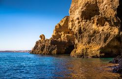 Lagos Caves and Seashore with its Esmerald and Blue Water. Exposure done in a boat tour in the Lagos seashore, Algarve, Portugal Stock Photography