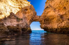 Lagos Caves and Seashore with its Esmerald and Blue Water. Exposure done in a boat tour in the Lagos seashore, Algarve, Portugal Royalty Free Stock Photo