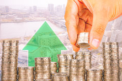 Exposure of Finance and Saving money banking concept,Hope of investor concept,Male hand putting money coin like stack growing busi. Ness. background the city Stock Image