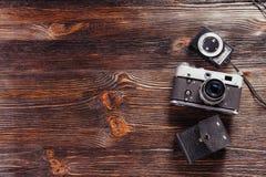 Exposure meter and retro camera Royalty Free Stock Photos