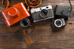 Exposure meter and retro camera Royalty Free Stock Images