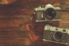 Exposure meter and retro camera Stock Images