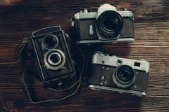 Exposure meter and retro camera Royalty Free Stock Image