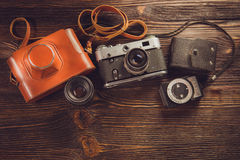 Exposure meter and retro camera Stock Photos