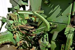 Exposure of an old tractor brake pedal. The levers, springs, and mechanisms attached to a brake pedal on an old green tractor are exposed with the removal of the Royalty Free Stock Photography