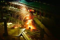 Exposure. Weld. Welding. Work. Worker. Work place. Light. Light beams. Night. Evening. Workhard. Hard work. Steel. Build. Dark. Red. Fire. Work belt. Outdoor Royalty Free Stock Photography