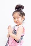 Expresión asiática Sawasdee de la recepción del niño de Liitle Imágenes de archivo libres de regalías