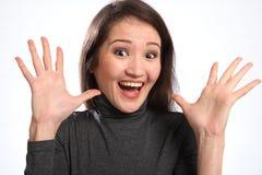 Expresión emocionada grande de la sorpresa de la mujer joven Imagen de archivo