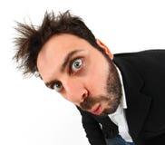 Expresión facial del hombre de negocios joven loco imagen de archivo libre de regalías