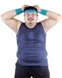 Expresión gorda del hombre agotadora Imagen de archivo libre de regalías