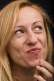 Expresión rubia de la mujer imagen de archivo