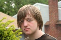 Expressão adolescente teimoso do menino Fotos de Stock Royalty Free