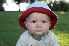 Expressões do bebê - mal-humoradas imagens de stock