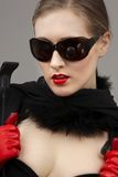 Express. Lady in black dress and red gloves with crop stock image