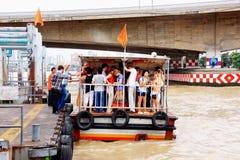 Express boat Bangkok. People get into Chao Phraya express boat at Memorial Bridge Bangkok, Thailand. The orange flag line Stock Photo
