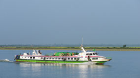 Express boat on the Kaladan River, Myanmar Royalty Free Stock Image
