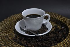 Express coffee cup on the tray. With coffee beans and black background stock photography