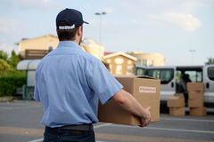 Express courier delivering box stock photography