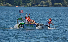 Express delivery milk carton boat. Seattle Seafair milk carton derby boat races,  Seattle, Washington, people make water Royalty Free Stock Images