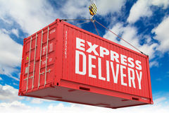 Express Delivery - Red Hanging Cargo Container. Stock Photo