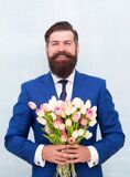 Express positivity. celebrate birthday party. businessman hold flowers gift. happy man ready for love date. valentines