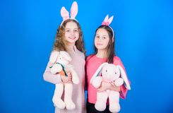 Express positivity. childhood happiness. Children in rabbit bunny ears. Happy easter. Spring holiday party. Egg hunt. Family and sisterhood. Little girls with stock photos