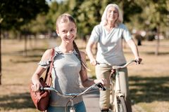 Portrait of smiling girl that posing on camera. Express positivity. Silhouette of mature women that feeling happiness while cycling and having outdoors stock photos