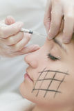 Express rejuvenation. Cosmetologist make woman express rejuvenation injection (fillers Royalty Free Stock Photo
