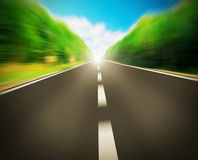Express road disappearing over the horizon. To the sun Royalty Free Stock Photo