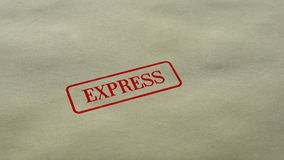 Express seal stamped on blank paper background, fast delivery service, customer. Stock footage stock footage