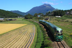 Express train of Japan. Green express train that runs in the background Yufu of Kyushu, Japan Royalty Free Stock Photos