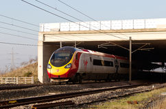 Express train out of tunnel Stock Photography