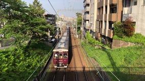 Express train passing through Shukugawa, Japan. Express train passing through Shukugawa on its way to Osaka, Japan stock footage