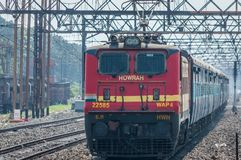 Express train pulled by an electric locomotive Engine royalty free stock photo