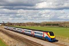 Express train in a rural setting. HARROWDEN, UK - MARCH 7: An East Midlands operated class 222 diesel unit hauls a semi fast passenger service towards Kettering Stock Photography