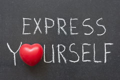 Express yourself. Phrase handwritten on chalkboard with heart symbol instead of O stock photography